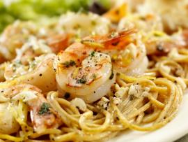 Scampi-style shrimp over whole wheat pasta.