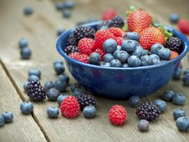 blueberries, raspberries and strawberries in bowl
