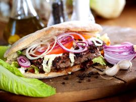 cilantro cumin burger with tahini dressing in pita bread