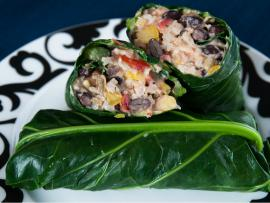 bean and vegetable burrito wrapped in a collard green leaf