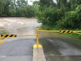 gate across road closing the Roanoke River greenway in a flood