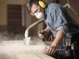 man using power tools wearing hearing protection