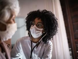 home health aide at patient's home both with masks