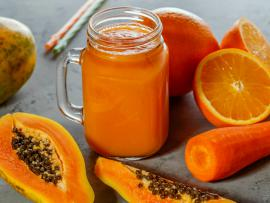 glass of mango, carrot and organe smoothie