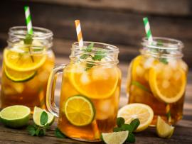 three mason jars with iced tea and citrus slices