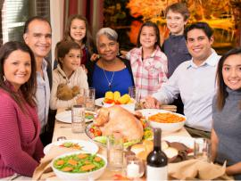 multi racial family enjoying a holiday dinner together