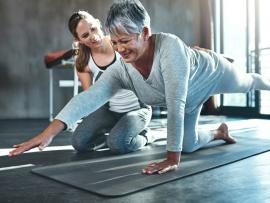 older woman doing physical therapy with a physical therapist