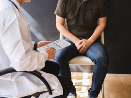male patient with doctor discussing prostate cancer diagnosis