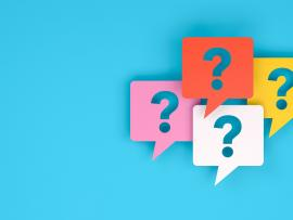 multicolored question mark icons on a blue background