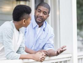father and teen son talking