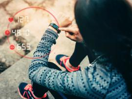 runner using wearable technology to track target heart rate zone