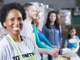 woman volunteering at shelter soup kitchen