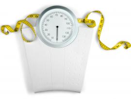 Bariatric weight loss surgery with measuring tape and scale