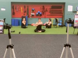 professional workout being filmed by iphone with social distancing