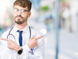 young doctor casually pointing in opposite directions indicating confusing choices
